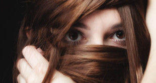 young-woman-hiding-w